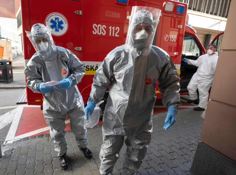 Slovak emergency personnel wearing protective suits enter the University hospital of Merciful Brothers where they are to a samples from 3 patients to be tested for the coronavirus COVID-19 in Bratislava, Slovakia on March 16, 2020. (Photo by JOE KLAMAR / AFP) (Photo by JOE KLAMAR/AFP via Getty Images)