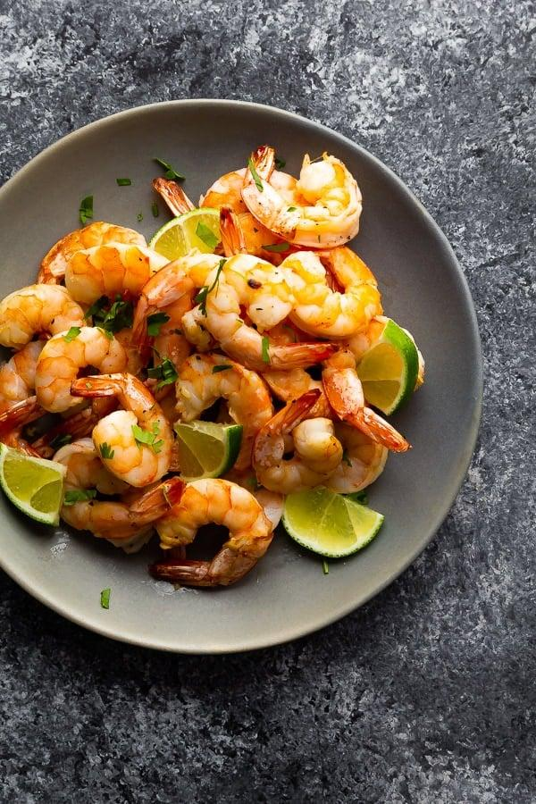 "<p>For a truly flavorful dinner, you'll need to let the shrimp marinate for about a half hour, but then it takes just five minutes to cook them in the air fryer. Serve them with cauliflower rice and veggies or atop a green salad.</p> <p><strong>Get the recipe:</strong> <a href=""http://sweetpeasandsaffron.com/air-fryer-shrimp/"" target=""_blank"" class=""ga-track"" data-ga-category=""Related"" data-ga-label=""http://sweetpeasandsaffron.com/air-fryer-shrimp/"" data-ga-action=""In-Line Links"">honey lime shrimp</a></p>"