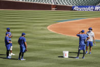 Chicago Cubs manager David Ross, right, talks to his players during baseball practice at Wrigley Field on Friday, July 3, 2020 in Chicago. (AP Photo/Kamil Krzaczynski)