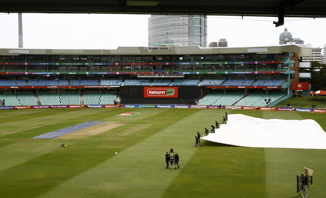 DURBAN, SOUTH AFRICA - OCTOBER 19: Covers brought on during the Karbonn Smart CLT20 match between Auckland Aces and Delhi Daredevils from Sahara Stadium Kingsmead on October 19, 2012 in Durban, South Africa. (Photo by Anesh Debiky/Gallo Images/Getty Images)