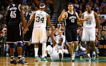 BOSTON, MA - NOVEMBER 28: Rajon Rondo #9 of the Boston Celtics is helped up by teammate Paul Pierce #34 after being fouled in front of Kris Humphries #43 of the Brooklyn Nets. This happened separate from the fight at the end of the second half.