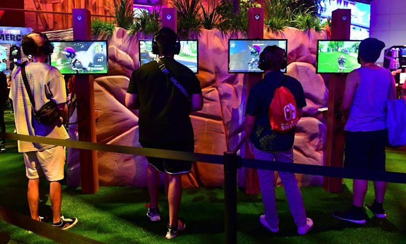 Gaming fans play Fortnite at E3 2018 in Los Angeles.