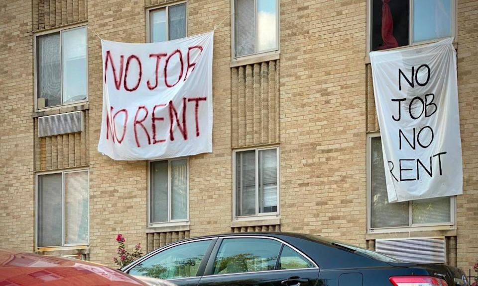 Banners saying 'no job, no rent' are displayed on a building in Washington DC on 9 August.