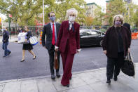 E. Jean Carroll arrives at the Daniel Patrick Moynihan United States Courthouse, Wednesday, Oct. 21, 2020, in New York. Carroll, who says President Donald Trump raped her in the 1990s, was expected to be in court Wednesday to hear lawyers argue whether Trump can substitute the United States for himself as the defendant in her defamation lawsuit. (AP Photo/John Minchillo)
