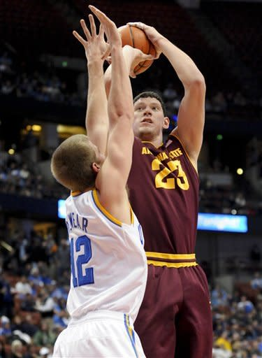 Arizona State center Ruslan Pateev (23), of Russia, shoots over UCLA forward David Wear (12) during the first half of an NCAA college basketball game, Saturday, Jan. 7, 2012, in Anaheim, Calif. (AP Photo/Gus Ruelas)