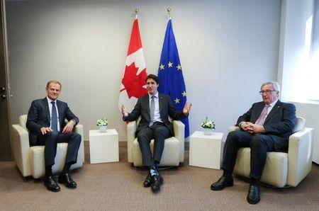 EU Council President Donald Tusk, Canadian PM Justin Trudeau and European Commission President Jean Claude Juncker meet before the signing of the Comprehensive Economic and Trade Agreement (CETA) at the European Council in Brussels