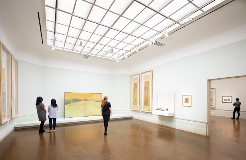 A historic octagonal gallery that has been restored now has a light box behind its skylight.