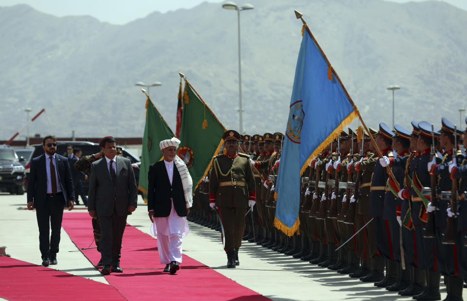 President Ashraf Ghani, center, inspects the honor guard during the extraordinary meeting of the Parliament in Kabul, Afghanistan, Monday, Aug. 2, 2021. (AP Photo/Rahmat Gul)