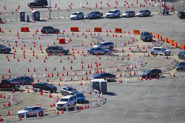 Los Angeles, CA - January 30: Cars with people coming for COVID-19 vaccine go through a maze of orange cones at Dodger Stadium on Saturday, Jan. 30, 2021 in Los Angeles, CA.(Irfan Khan / Los Angeles Times)