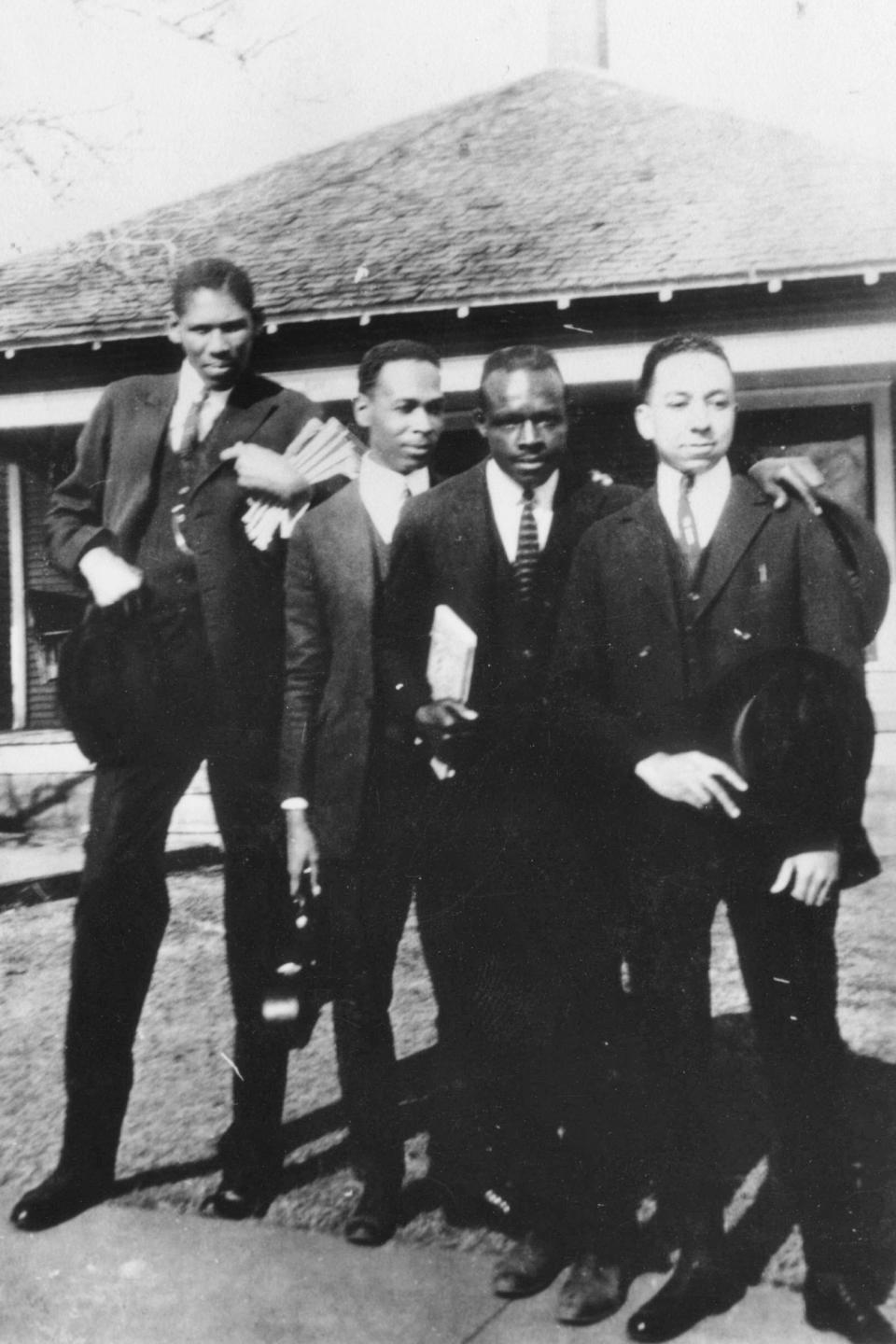 This photo provided by the Department of Special Collections, McFarlin Library, The University of Tulsa shows James T. A. West, an instructor at Booker T. Washington High School and three other Black men. It is believed that the photo was taken in Tulsa, Okla. prior to the Tulsa Race Massacre in 1921. (Department of Special Collections, McFarlin Library, The University of Tulsa via AP)