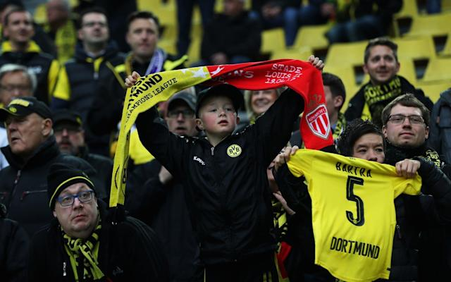 <span>Dortmund fans display a shirt for Marc Bartra who was injured in the team coach attack prior to the UEFA Champions League Quarter Final first leg match between Borussia Dortmund and AS Monaco</span> <span>Credit: Maja Hitij/Bongarts </span>