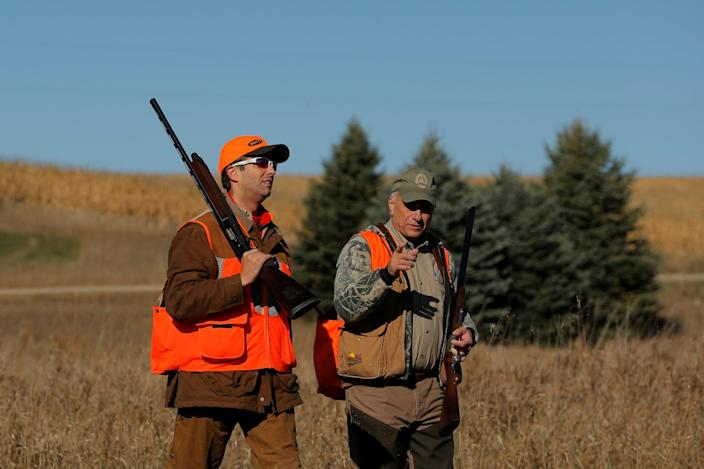 Donald Trump Jr. (L) walks with Rep. Steve King (R-IA) after the Colonel Bud Day memorial pheasant hunt near Akron, Iowa, U.S., October 28, 2017.