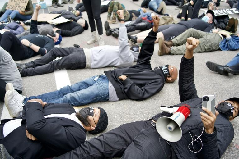 Protesters demonstrate outside the Hennepin County Family Justice Center in Minneapolis as four former police officers accused of killing George Floyd appeared inside