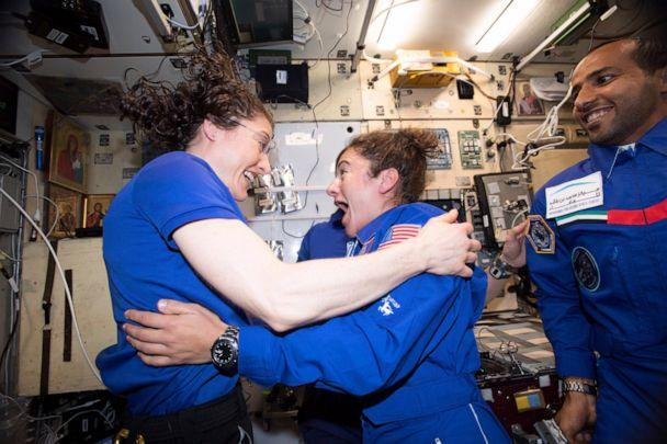PHOTO: Christina H. Koch and Jessica Meir greet each other after Meir's arrival on the International Space Station, Sept. 4, 2019. (NASA via AP)