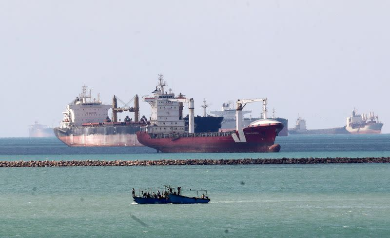 Ships and boats are seen at the entrance of Suez Canal, which was blocked by stranded container ship Ever Given that ran aground