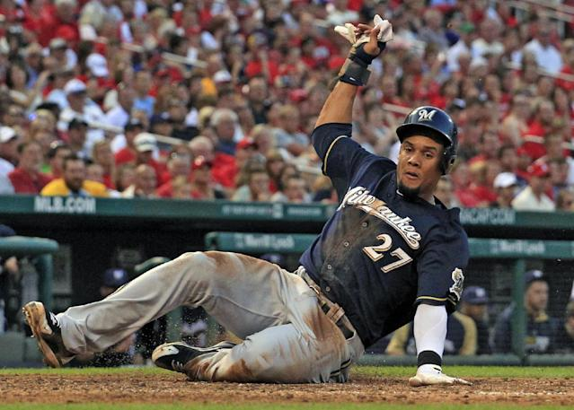 Milwaukee Brewers' Carlos Gomez scores during the fifth inning of a baseball game against the St. Louis Cardinals Saturday, Aug. 2, 2014, in St. Louis. (AP Photo/Jeff Roberson)