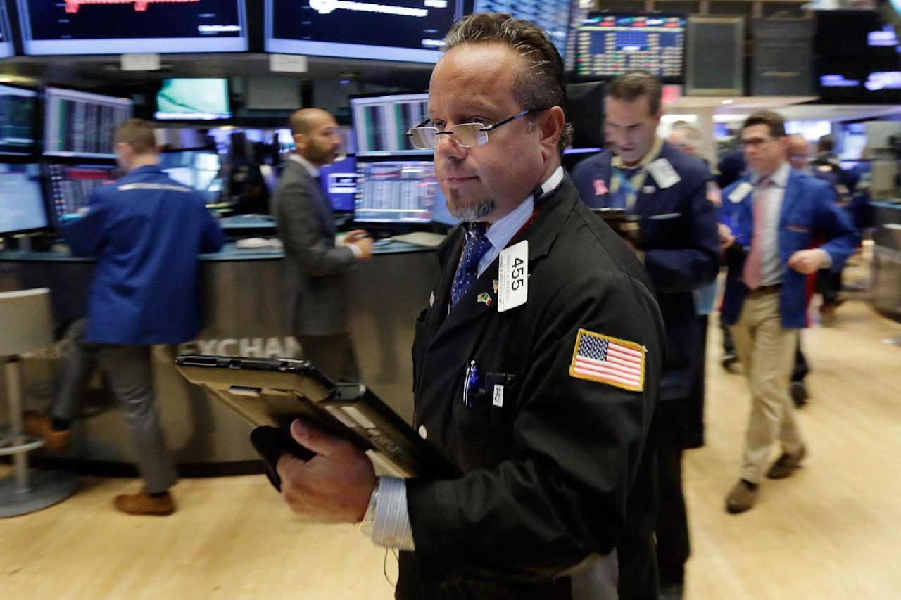 Trader Robert Arciero works on the floor of the New York Stock Exchange, Wednesday, July 27, 2016. Stocks are opening higher, led by gains in technology stocks after Apple posted solid quarterly earnings. (AP Photo/Richard Drew)