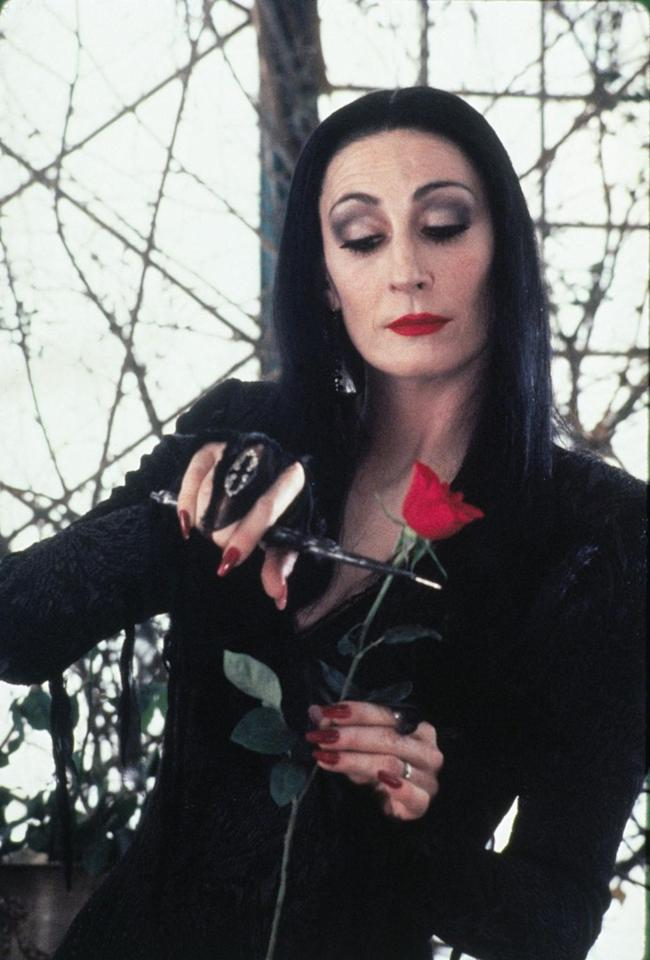 """<p>The stunning and mysterious Morticia Addams was played by the effervescent<span class=""""redactor-invisible-space""""> Anjelica Huston.</span> </p>"""