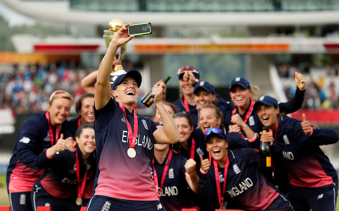 Cricket - Women's Cricket World Cup Final - England vs India - London, Britain - July 23, 2017   England's Katherine Brunt celebrates winning the world cup by taking a selfie with team mates   Action Images via Reuters/John Sibley     TPX IMAGES OF THE DAY