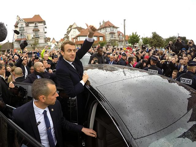 <p>French independent centrist presidential candidate Emmanuel Macron shakes hands with well-wishers as he leaves the polling station after casting his ballot in the presidential runoff election in Le Touquet, France, Sunday, May 7, 2017. (Philippe Wojazer/Reuters) </p>