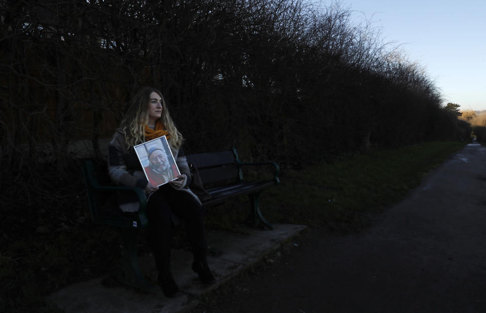 Jo Goodman holds a portrait of her late father Stuart as she poses for a photo in London, Friday, Jan. 22, 2021. Jo's father Stuart died of COVID-19, in April 2020. A couple of months after her father died, Goodman, 32, co-founded the COVID-19 Bereaved Families for Justice group to pressure the government to back a public inquiry into how the pandemic was handled last spring. (AP Photo/Alastair Grant)