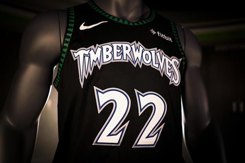 big sale bbf79 9315f Timberwolves bring back classic pine tree uniforms