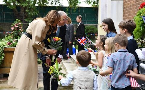 Philip May and Melania Trump at the 10 Downing Street garden party - Credit: REX