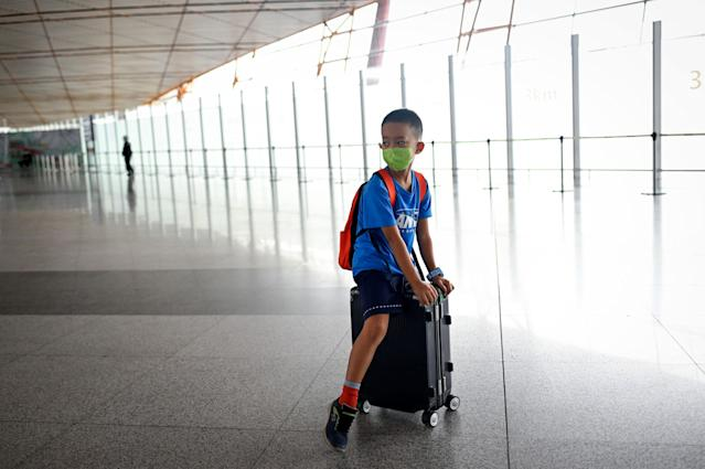 A boy wears a mask at Beijing's international airport. (Getty Images)