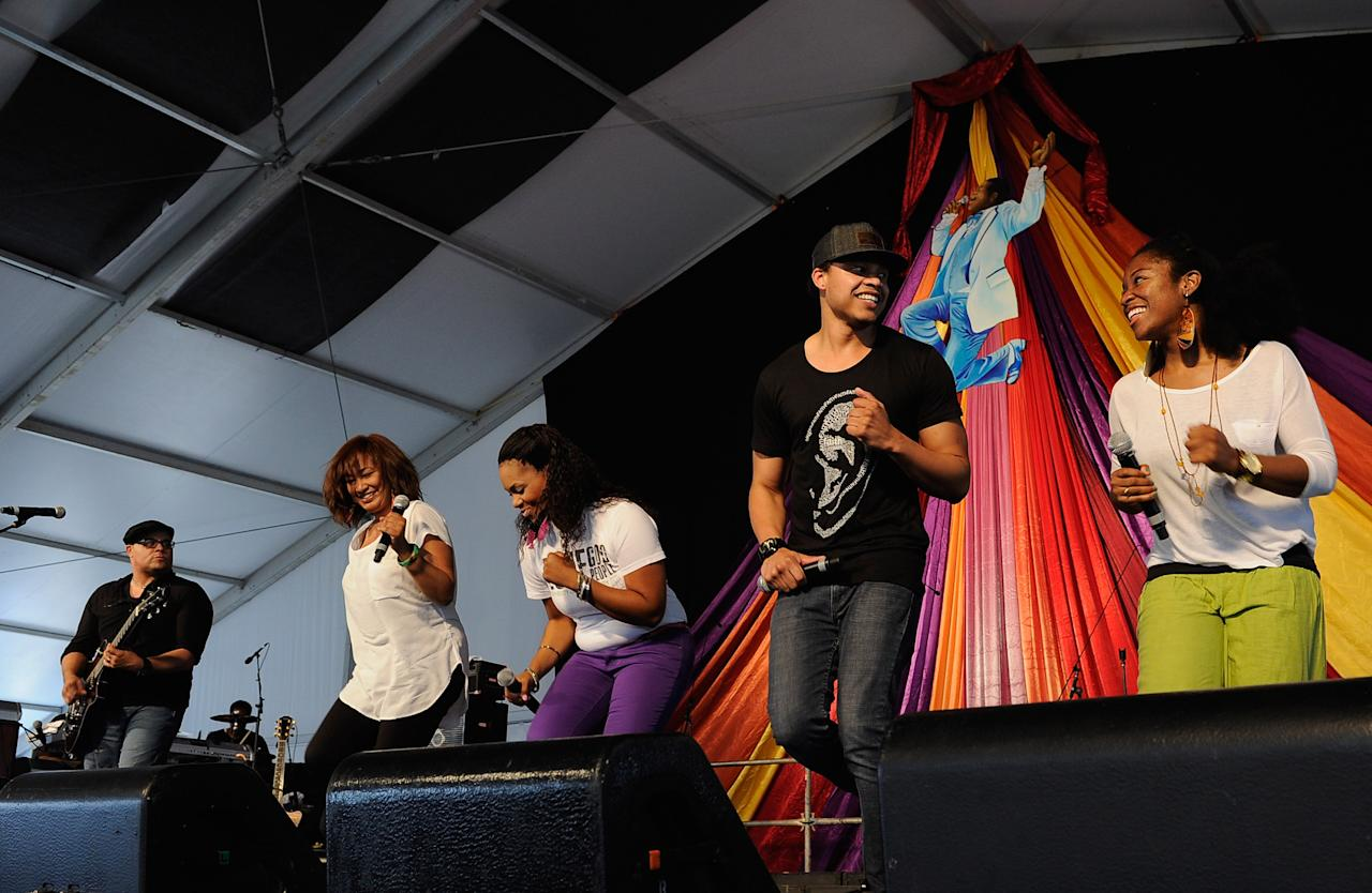 NEW ORLEANS, LA - APRIL 28:  Israel Houghton (left) and New Breed performs during the 2012 New Orleans Jazz & Heritage Festival Day 2 at the Fair Grounds Race Course on April 28, 2012 in New Orleans, Louisiana.  (Photo by Rick Diamond/Getty Images)
