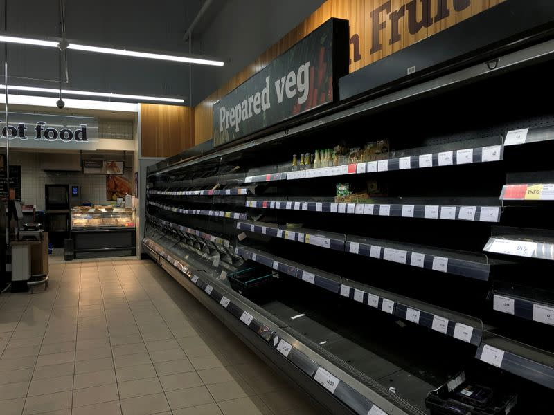 Empty shelves are seen at a Sainsbury's store in south London as the numbers of coronavirus cases continues to rise around the world