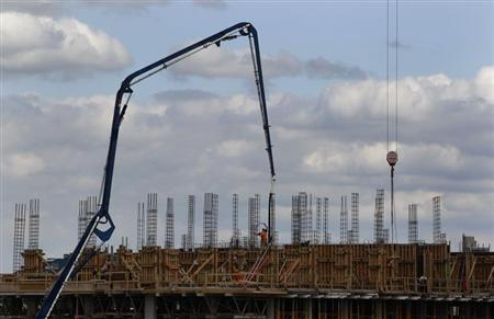 People work at a construction site in Vancouver, British Columbia