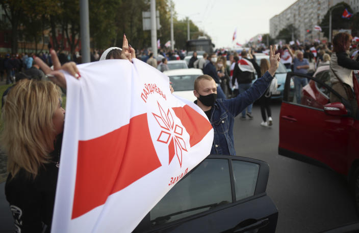 People march during an opposition rally to protest the official presidential election results in Minsk, Belarus, Sunday, Oct. 4, 2020. Hundreds of thousands of Belarusians have been protesting since the Aug. 9 presidential election. (AP Photo)