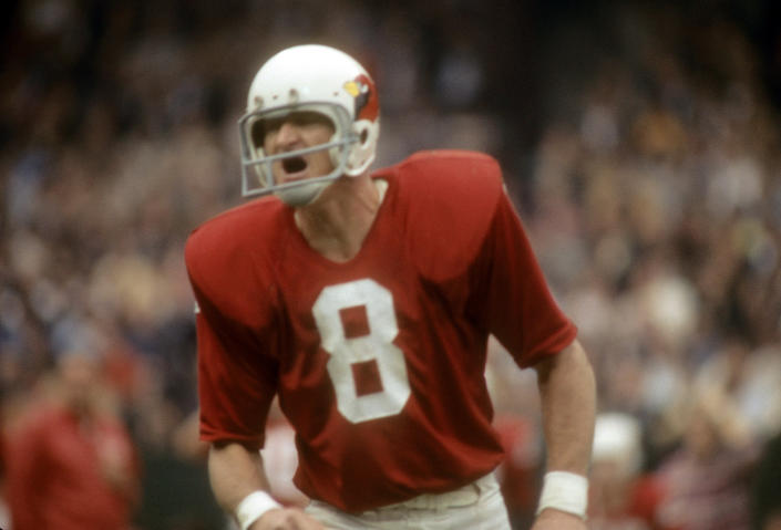 Larry Wilson in an old all-red with white letter No. 8 jersey.