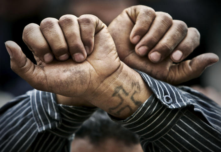 FILE - In this Friday, April 14, 2006 file photo, Egyptian Copts cross their wrists in defiance outside the Saints Church in the Sidi Bishr district of Alexandria in Egypt. The Christian community, which makes up 10 percent of Egypt's population of 85 million, see the upcoming election, June16-17 as a clear-cut choice between a state or one in which a hidden Islamist agenda slowly takes root. Leaders of the Orthodox Coptic Church, to which most Egyptian Christians belong, and Christian activists have been working hard to ensure the community goes to the polls and unites behind one candidate. (AP Photo/Ben Curtis, File)