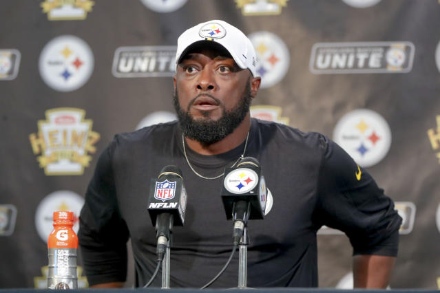 FILE - In this Aug. 9, 2019, file photo, Pittsburgh Steelers head coach Mike Tomlin arrives for a news conference after an NFL preseason football game against the Tampa Bay Buccaneers in Pittsburgh. Tomlin's seat isn't hot, but the decision to sign him to a one-year extension through 2021 (with an option for a second) instead of something longer term sent a message that being a contender might not be good enough. (AP Photo/Keith Srakocic, File)