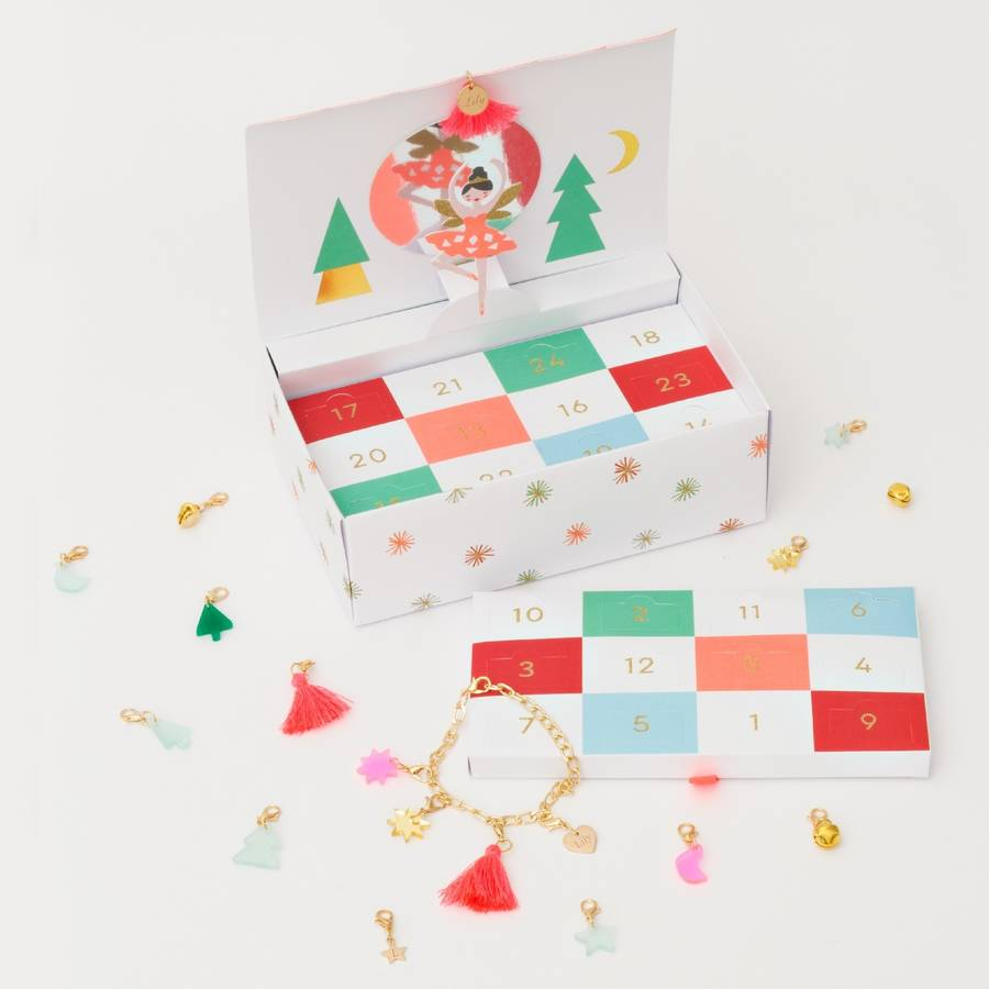 """<p>This lovely advent calendar comes in a luxury ballerina box with lots of tiny boxes for each day. Choose to add a hand stamped initial star to the charm selection, an engraved heart or birthstone.<br></p><p>£24.65 <a href=""""https://www.bloom-boutique.co.uk/luxury-personalised-advent-calendar"""" rel=""""nofollow noopener"""" target=""""_blank"""" data-ylk=""""slk:Bloom Botique"""" class=""""link rapid-noclick-resp"""">Bloom Botique</a></p>"""