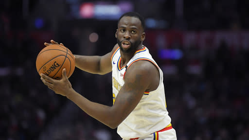 Golden State Warriors forward Draymond Green passes the ball during the second half of an NBA basketball game against the Los Angeles Clippers Friday, Jan. 10, 2020, in Los Angeles. The Clippers won 109-100. (AP Photo/Mark J. Terrill)