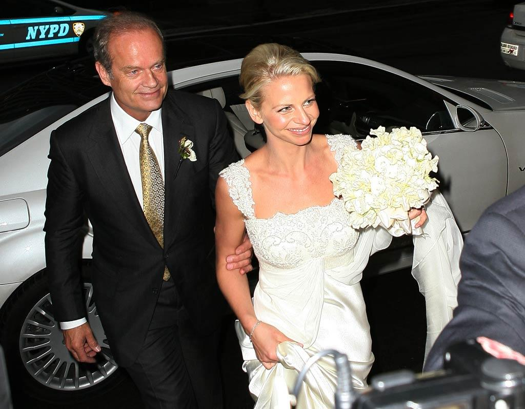 "Kelsey Grammer, 56, and Kayte Walsh, 29, were married by a drag queen on the stage at NYC's Longacre Theater Friday, where Kelsey had just finished his run in the Broadway musical ""La Cage Aux Folles."" The couple then headed over to the Plaza Hotel's famed Grand Ballroom for their reception dinner. Good luck for your fourth time around, Kelsey! <a href=""http://www.splashnewsonline.com"" target=""new"">Splash News</a> - February 25, 2011"