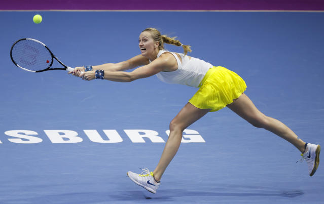 Petra Kvitova of Czech Republic returns the ball to Alison van Uytvanck of Belgium during the St. Petersburg Ladies Trophy-2020 tennis tournament match in St.Petersburg, Russia, Thursday, Feb. 13, 2020. (AP Photo/Dmitri Lovetsky)