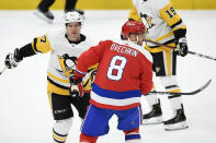 FILE - In this Feb. 2, 2020, file photo, Washington Capitals left wing Alex Ovechkin (8), of Russia, skates next to Pittsburgh Penguins center Sidney Crosby (87) during the third period of an NHL hockey game in Washington. The NHL is embarking on a 56-game regular season with all divisional play in a knock-down, drag-out battle for the Stanley Cup unlike any other in hockey history. (AP Photo/Nick Wass, File)