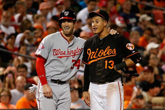 BALTIMORE, MD – JULY 10: Bryce Harper #34 of the Washington Nationals and Manny Machado #13 of the Baltimore Orioles talk during their game at Oriole Park at Camden Yards on July 10, 2015 in Baltimore, Maryland. (Photo by Rob Carr/Getty Images)