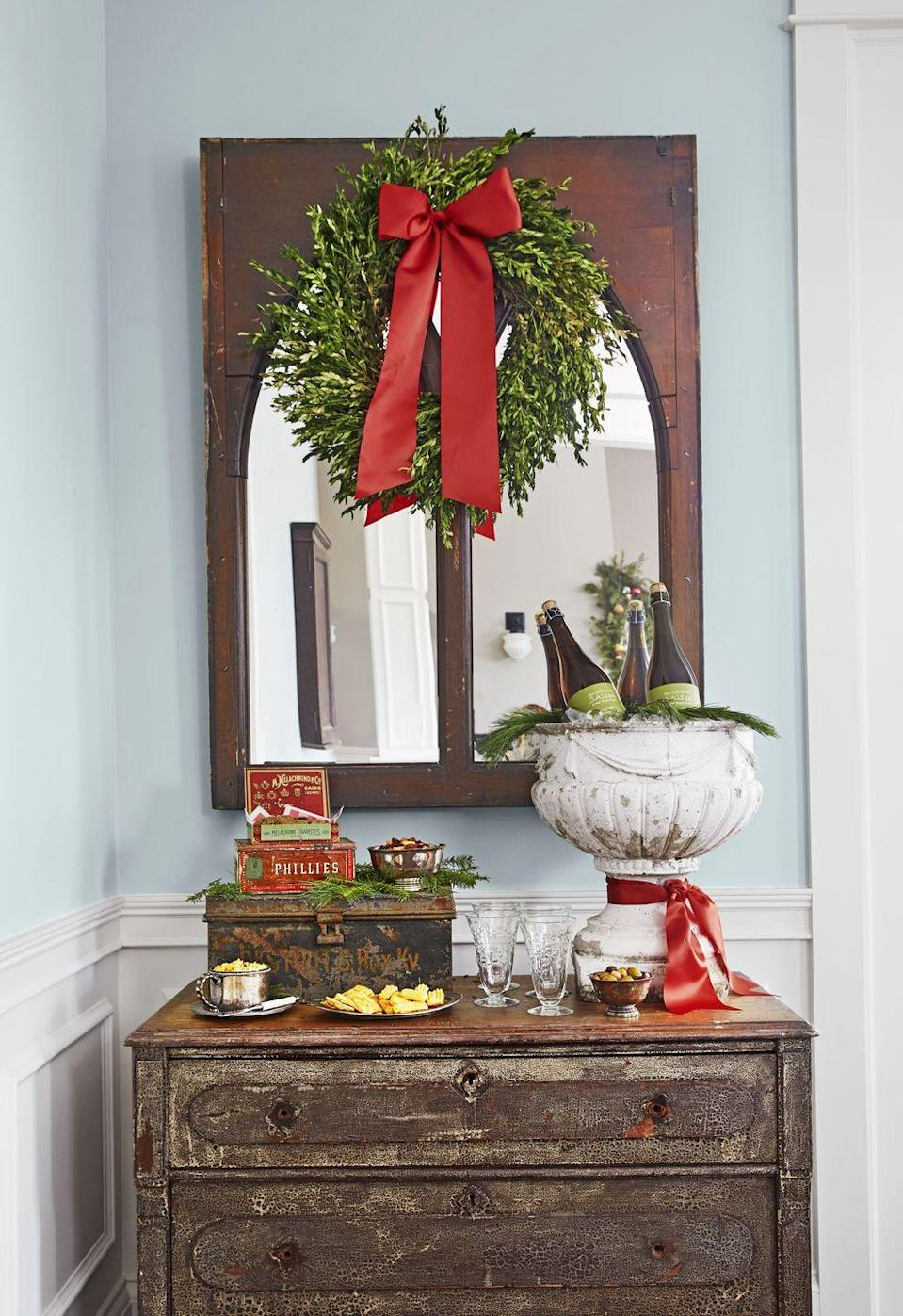 """<p>While <a href=""""https://www.countryliving.com/diy-crafts/how-to/g1056/diy-wreath-ideas/"""" rel=""""nofollow noopener"""" target=""""_blank"""" data-ylk=""""slk:wreaths"""" class=""""link rapid-noclick-resp"""">wreaths</a> are the go-to decoration for front doors and mantels, they're also the perfect piece to hang over windows, mirrors, and even framed artwork. </p><p><a class=""""link rapid-noclick-resp"""" href=""""https://www.amazon.com/Tradingsmith-Preserved-Boxwood-Wreath-12/dp/B01CF8YZSM/?tag=syn-yahoo-20&ascsubtag=%5Bartid%7C10050.g.1247%5Bsrc%7Cyahoo-us"""" rel=""""nofollow noopener"""" target=""""_blank"""" data-ylk=""""slk:SHOP BOXWOOD WREATHS"""">SHOP BOXWOOD WREATHS</a></p>"""