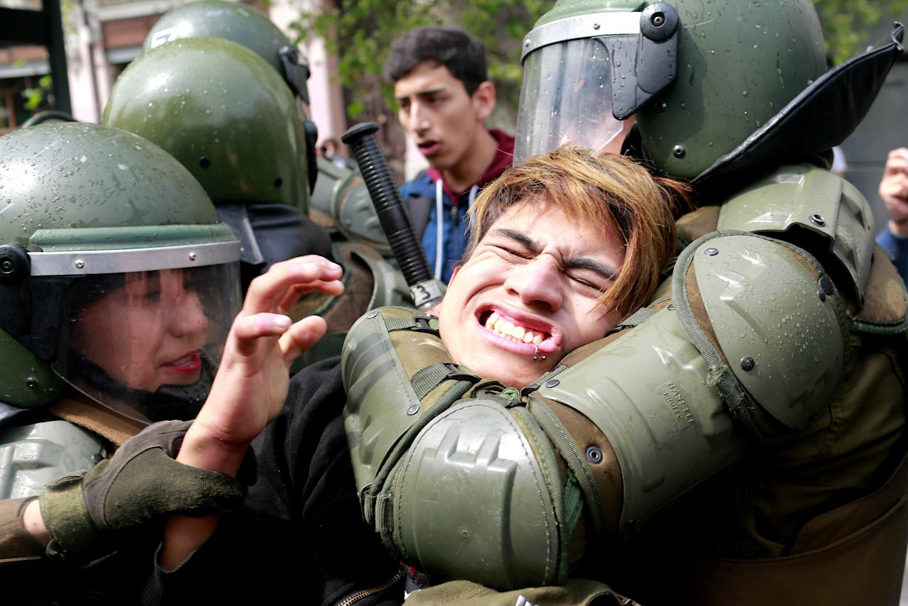 A demonstrator is detained during a rally to request change in the education system in Santiago, Chile September 27, 2017. REUTERS/Pablo Sanhueza     TPX IMAGES OF THE DAY