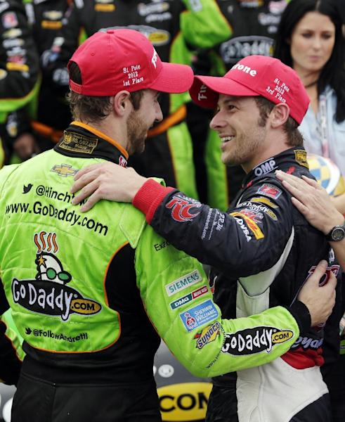 Winner James Hinchcliffe, left, of Canada, congratulates third-place finisher Marco Andretti after the IndyCar Series Honda Grand Prix of St. Petersburg auto race, Sunday, March 24, 2013, in St. Petersburg, Fla. (AP Photo/Chris O'Meara)