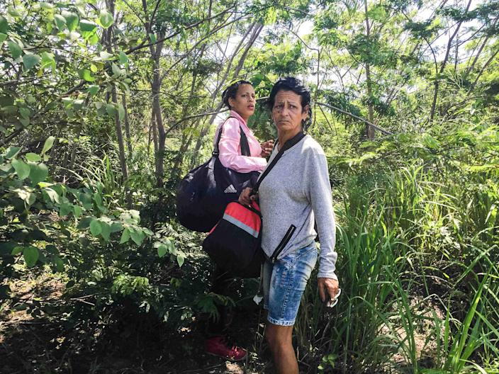 May 14, 2016 - After crossing into Brazil, Marta and Liset wait nervously for the signal to run to awaiting cars. (Photo: Lisette Poole)