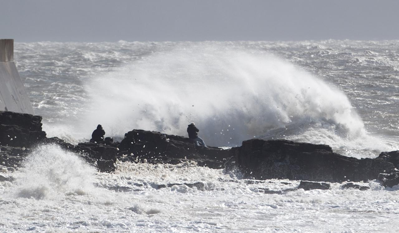 <p>Waves crash against the sea wall at Cromer in Norfolk after Storm Aileen brought howling gusts and heavy showers to parts of the UK. Parts of England and Wales had been experiencing gusts of 55-65mph winds, the Met Office said.(PA) </p>