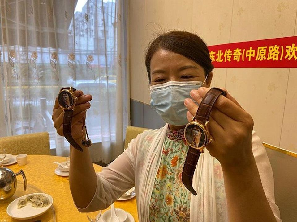 Xu Dongmei, Yao's non-biological mother, holds a pair of Shanghai-branded Year of the Monkey commemorative watches – birthday gifts she prepared for Yao and Guo Wei, her biological son. Photo: Jiemian.com