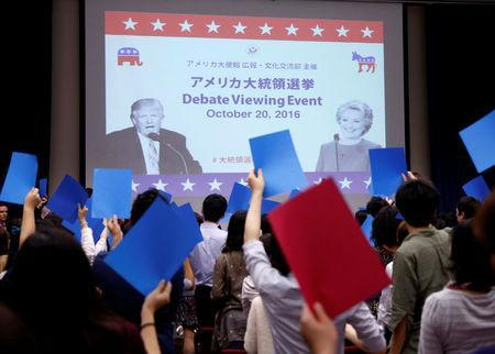 Invited students attend an event to watch the televised U.S. presidential debate between Democratic U.S. presidential nominee Hillary Clinton and Republican U.S. presidential nominee Donald Trump, at the U.S. Embassy in Tokyo, Japan October 20, 2016. REUTERS/Issei Kato