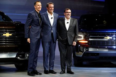 General Motors Global Design chief Michael Simcoe, GM Executive Vice President for Global Product Development Mark Reuss and GM North America President Alan Batey unveil new Chevy Silverado trucks at the North American International Auto Show in Detroit, Michigan, U.S. January 13, 2018.  REUTERS/Jonathan Ernst