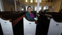 Maria Macario poses for a portrait at the First Parish church, Wednesday, Jan. 27, 2021, in Bedford, Mass. For three years, Macario has been too afraid to leave the confines of the church, which she moved in to avoid deportation, spending most of her time in a converted Sunday school classroom stocked with a hot plate, mini-fridge, TV and single bed. (AP Photo/Charles Krupa)